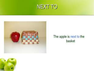 NEXT TO The apple is next to the basket