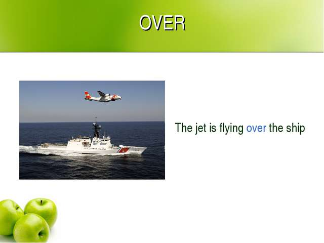 OVER The jet is flying over the ship