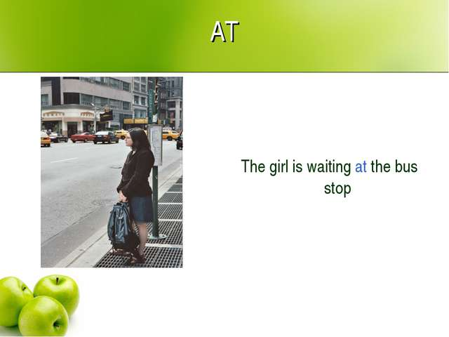AT The girl is waiting at the bus stop