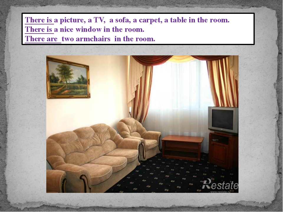 There is a picture, a TV, a sofa, a carpet, a table in the room. There is a n...