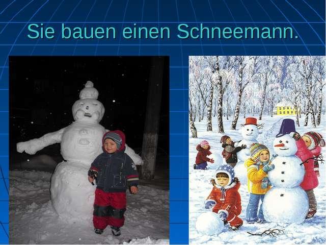 Sie bauen einen Schneemann.