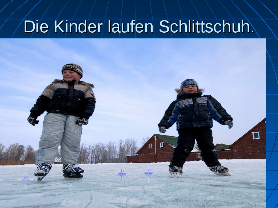 Die Kinder laufen Schlittschuh.